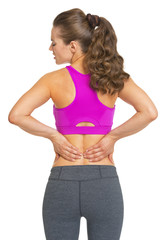 Female athlete having backache