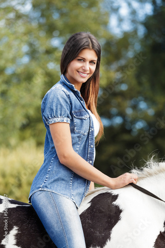 portrait of beautiful young female rider