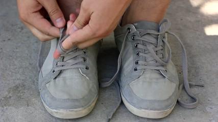 man tying his shoelaces