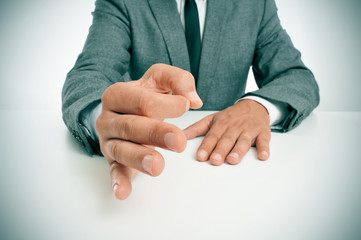 man in suit gesturing as affirming his speech
