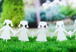 Paper people in social network concept on green grass outdoors