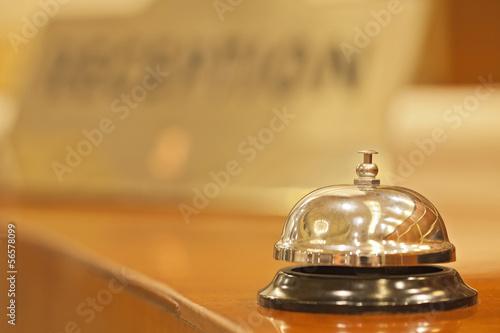 Leinwandbild Motiv old hotel bell on a wood stand
