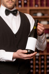 Confident sommelier. Cropped image of confident young sommelier
