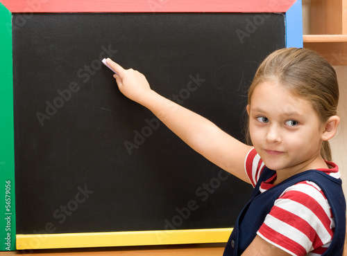 pupil writes with chalk
