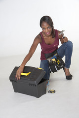 Female worker with toolbox