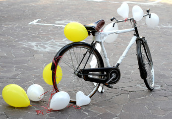 decorated bicycle to make a joke to two future bride and groom j