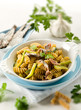 fusilli with anchovies and zucchinis, selective focus