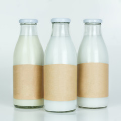 Bottles of milk with blank paper labels. Just add your text