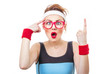 Surprised fitness woman gesturing finger up