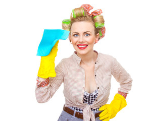 Funny young cheerful housewife with gloves