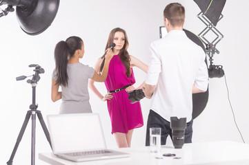 Fashion model at studio. Beautiful young female fashion model po