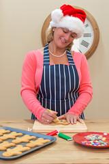 Woman icing gingerbread men