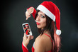 Beautiful sexy girl wearing santa claus clothes with smartphone