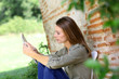 Girl connected on internet in country home garden