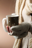 Fototapety Female hands with hot drink, on color background