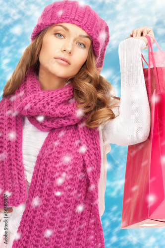 woman in winter clothes with shopping bags