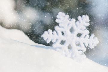 big snowflake toy in snowdrift