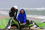 kitesurfers preparing kite