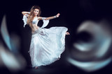 Beautiful exotic belly dancer woman running on the waves. isolat