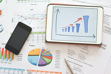 analysis financial planning document with mobile phone