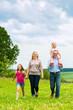 Happy Family walking in the meadow