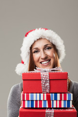 Beautiful woman holding Christmas presents