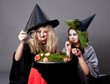 Halloween party - girls in costumes of witches