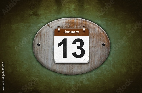 Old wooden calendar with January 13.