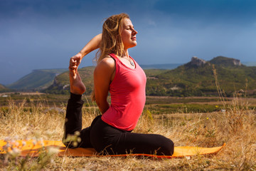 Young woman make yoga pose deeply concentrated