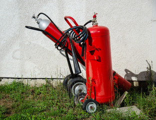 Two large fire extinquishers on the wheels