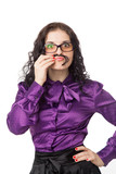 brunette woman wearing shirt, skirt and glasses making moustache
