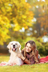 Young female in a park with her dog