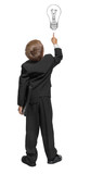 Child  in a tuxedo pointing at wall. Rear view. Isolated over wh