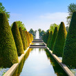 Garden in Keukenhof, conical hedges and fountain. Netherlands