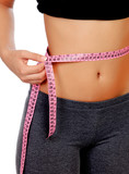Woman waist with measuring tape