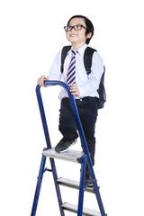 Child climbs up a ladder