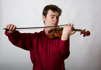 Virtuoso Teen Male Violinist in red