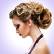 Profile portrait of  woman with fashion  hairstyle