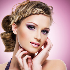 woman with fashion hairstyle and pink makeup