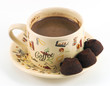 Cup of coffee with chocolate candy