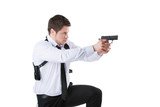 Bodyguard. Confident young man holding gun while standing isolat poster