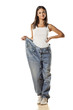 happy pretty attractive girl posing in huge pants on white