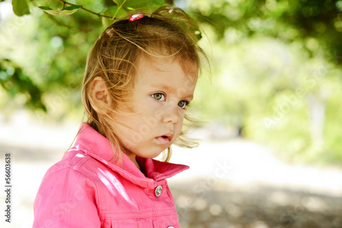 toddler girl in windy weather