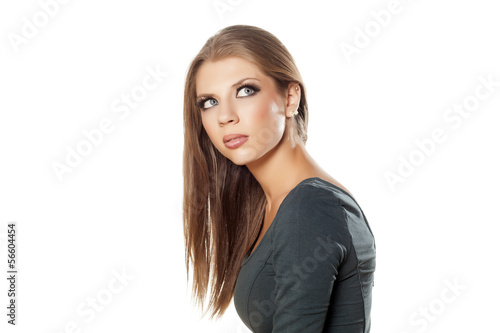 young attractive girl looking unclear at someone
