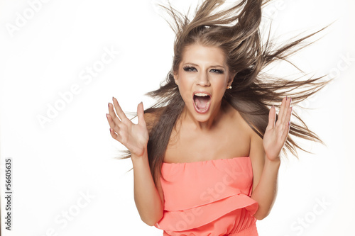 beautiful girl in a dress posing with wind in her hair