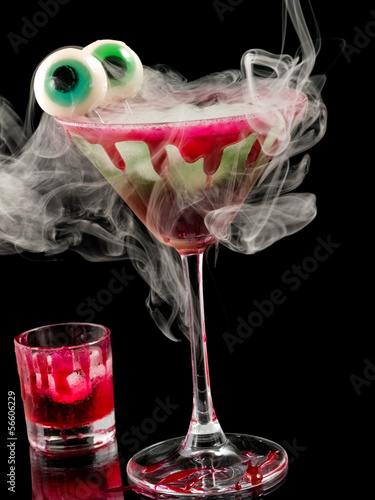 Halloween cocktail with eyes and smoke