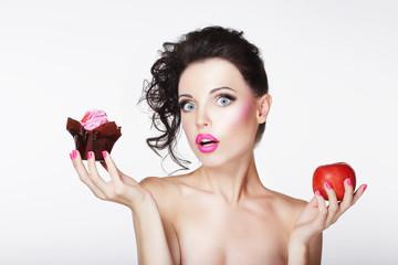 Dieting. Unsure Bewildered Girl Choosing Apple or Cake