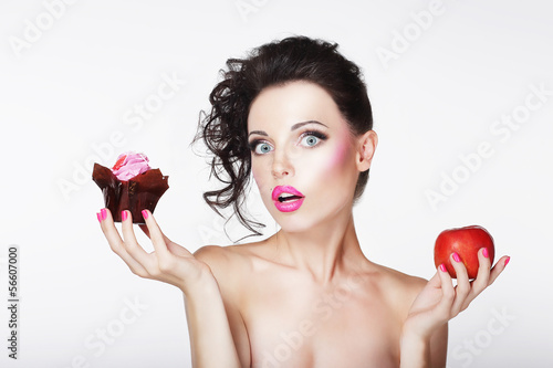 Dieting. Unsure Bewildered Girl Choosing Apple or Cake