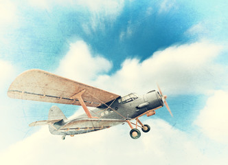 Old biplane in the sky