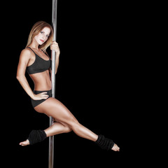 Sexy pole dancer on black